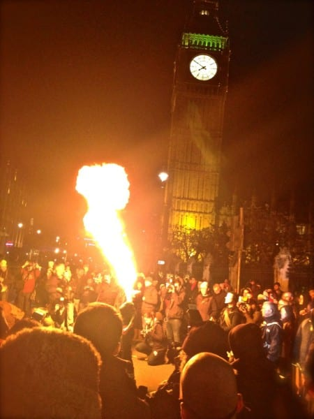 A fire breather entertains the protesters